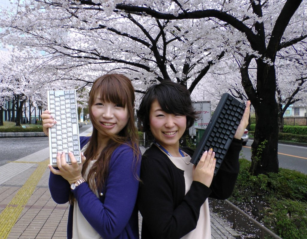 girls holding Happy Hacking Keyboard Japan